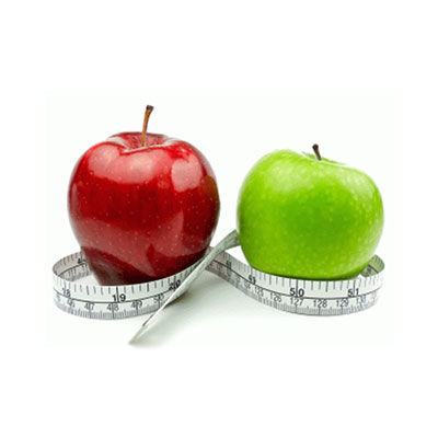 A red and green apple with measuring tape
